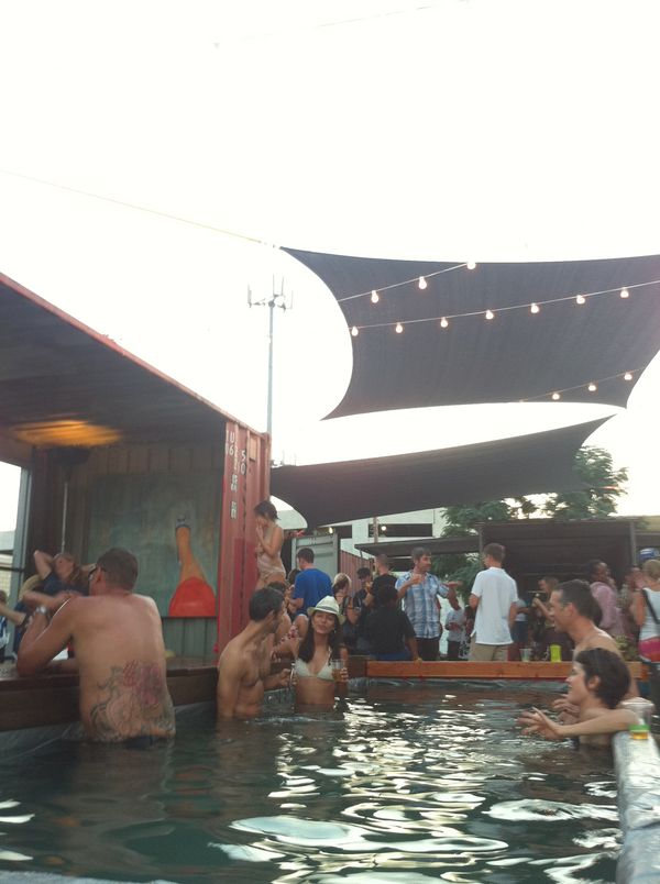 Dumpster pool and shipping container lounge
